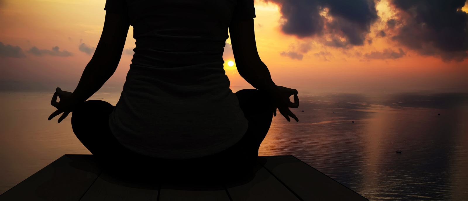 Woman meditating for World Mental Health Day 2021